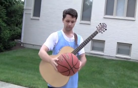 Teenager Plays Guitar While Shooting Some Bball